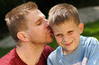 Father give kiss for his son
