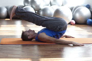 mind, body control - man practicing pilates
