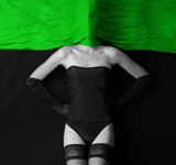 A bizarre shoot of a young woman in dark erotic lingerie poster