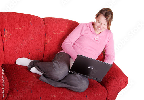 Young pretty women on couch using laptop