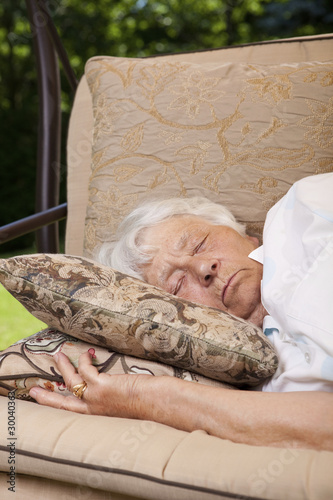 Senior woman sleeping outside