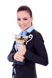 female entrepreneur holding a trophy poster