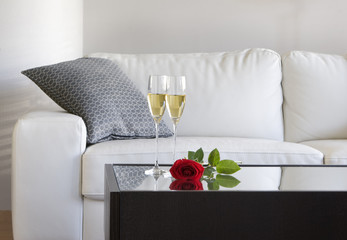 champagne and rose on modern coffee table