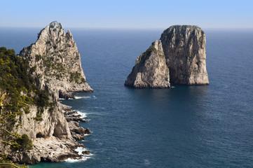 The iconic Faraglioni Rocks off the island of Capri in Italy