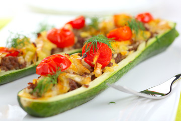 Zucchini stuffed with meat, onions and vegetables