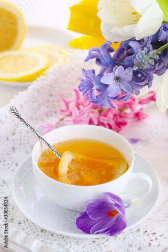 cup of tea with lemon and spring flowers