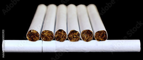 Smoking cigarettes isolated on black background
