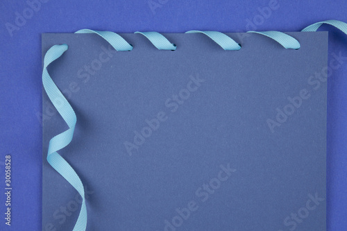 Blue paper with ribbon
