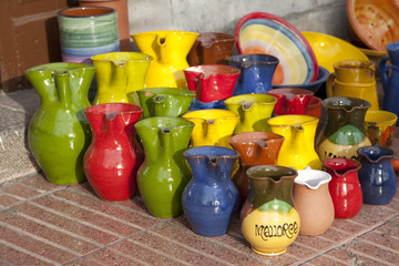 Colorful souvenir jugs for sale outside shop in Majorca, Spain