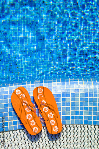orange fliplops at the pool