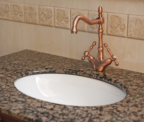 Bathroom washbasin and tap