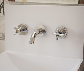 Bathroom tap on a washbasin