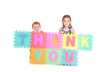 Kids holding thankyou sign