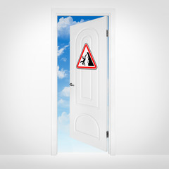 Opened door to blue sky with danger sign on it