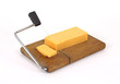 Sharp cheddar cheese being sliced