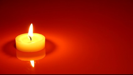 Close up of a candle is lit