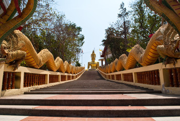 Long stairs to Buddha Statue in Thailand.