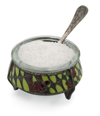old salt container with spoon and salt