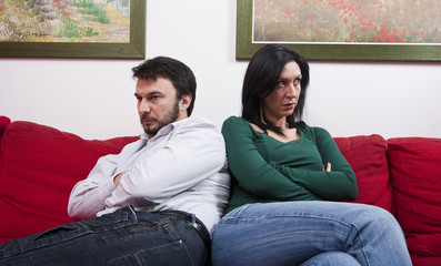 Angry Adult Couple Sitting on Sofa