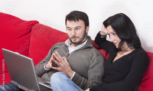 Portrait of a Relaxed Adult Couple Using Laptop at Home