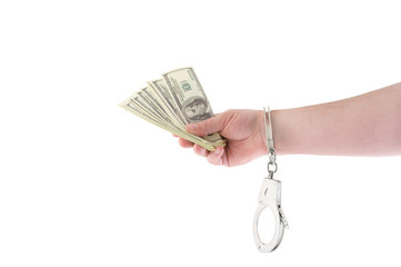 Hand with money and handcuffs isolated on white
