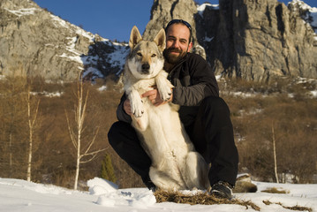 Man and his Czechoslovakian wolf dog