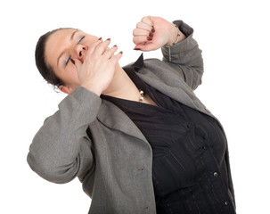 overweight, fat businesswoman yawning and stretching