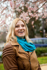Beautiful blonde woman at spring, with cherry tree
