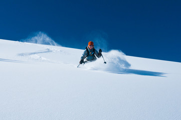 mature woman skiing un tracked powder snow