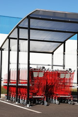 Red Shopping Trolleys Outdoors vertical