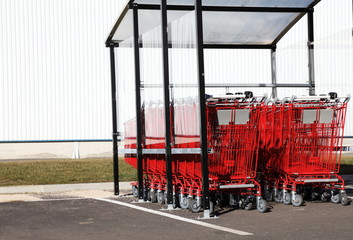 Red Shopping Trolleys Outside