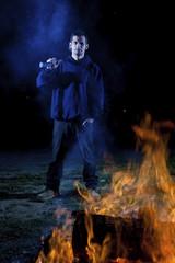 Axe wielding maniac by a fire