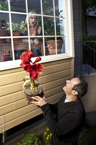 Romantic stalker offering flowers to freaked out woman