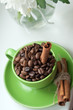 Coffee beans in a green cup