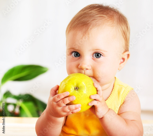 Little baby eating apple
