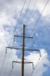 Electricity Pylon Over Cloudy Sky