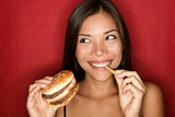 Junk food woman eating burger - 30107913