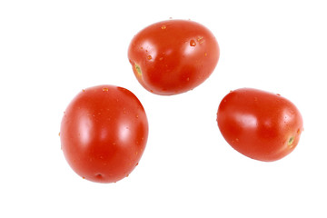Three Plum Tomatoes Isolated On White
