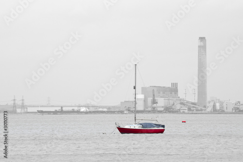 red sailing boat on anchor mooring