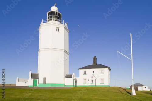 white light house on a sunny day