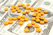 orange pill at the money , abstract business medical background