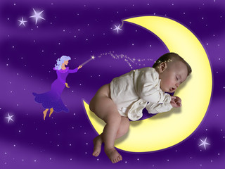 A sleeping baby on a moon