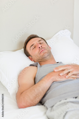 Man sleeping on his bed
