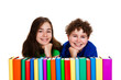 Kids behind pile of books isolated on white background
