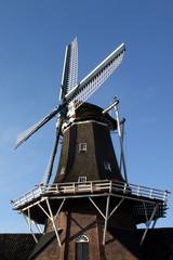 Old dutch windmill in Roderwolde in the Netherlands