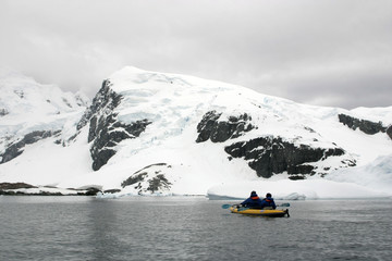 Kayaking in Antarctica, snow and cloudy