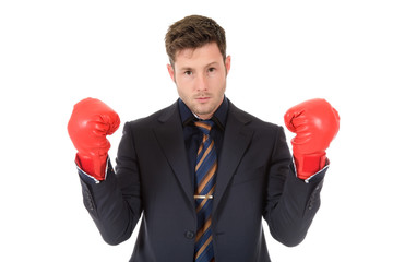 Young caucasian businessman, boxing gloves