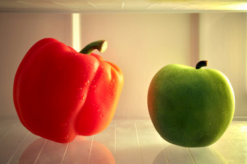 Red Sweet Pepper and green apple in Refrigerator