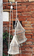 Fishing nets hanged to a wall in Venice