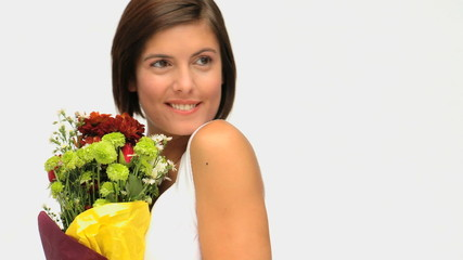 Wonderful brunette holding a bunch of flowers